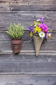 two wicker baskets with flowers and