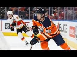 Flames sign Brandon Davidson and Byron Froese - YouTube