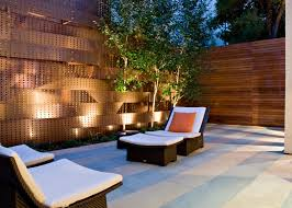 Landscape Lighting Illuminates Asian Patio And Copper Accent Wall With Intertwined Birch Trees Hgtv