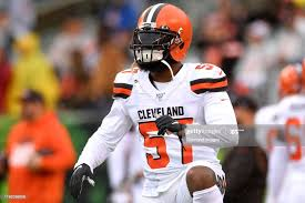 Outside linebacker Adarius Taylor of the Cleveland Browns stretches... News  Photo - Getty Images