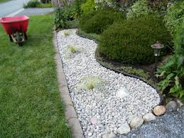 to use river rock landscaping mile