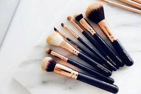 gold and black makeup brushes pictures