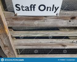 Wood Fence With Black And White Staff Only Sign Stock Image Image Of Wooden Sign 179989001