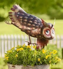 our metal yoga owl garden sculpture is