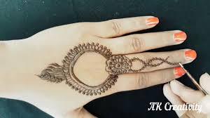 mehndi design on back fingers