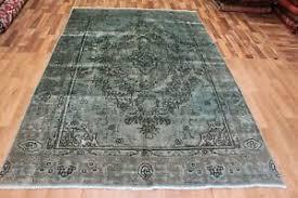handmade persian rug overd green rug