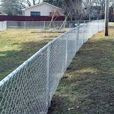 Chain Link Fencing If You Re Looking For A Durable Fence That Will Last For Years To Come But Doesn T Cost A Fortune Chai In 2020 Yard Installation Fencing Material