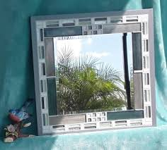 mirror with teal and gray glass tile