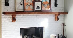 white painted brick fireplace with wood