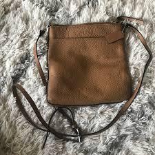 light brown genuine leather cross
