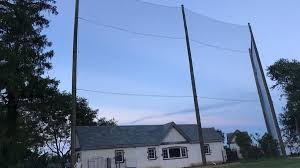 New Jersey Man Who Built 64 Foot High Fence To Stop Golf Balls Faces Heat From Neighbors To Remove Hideous Mega Structure New York Daily News