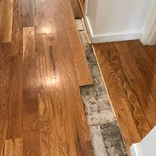 how to repair buckled wood floors