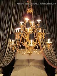light ornate polished brass chandelier
