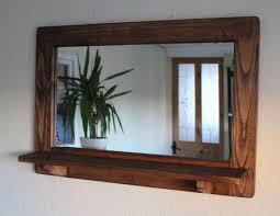 large mirror with shelf dark wood