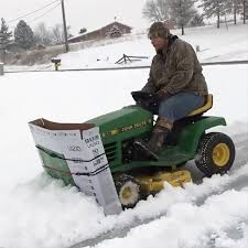 clever man plows snow using a large
