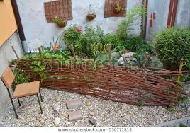 Tiny Little Garden Behind Willow Twigs Stock Photo Edit Now 530771818