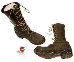Spike-soled caulk boots provide the logger with traction on the  springboard. This pair was worn around 1950 by Melvin Hawkins, w… | Boots,  Caulk boots, Combat boots