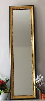 wall mirror in gold carved wood mirror