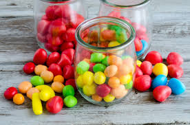 colorful cans in glass jar and