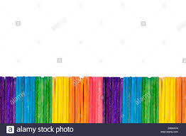 Abstract Background A Simple Fence Border Made Of Ice Cream Popsicle Sticks Alligned In A Pattern A Single Row Isolated On White Stock Photo Alamy