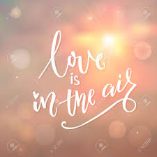 love is in the air r tic quote calligraphy on morning sky