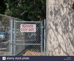 Danger Keep Out Sign Behind A Residential Chain Link Fence In Residential Area Stock Photo Alamy