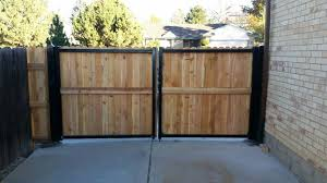 5 Wood Gate With Steel Posts And Framework Installed In Arvada Wood Fence Steel Fence Posts Fence Doors