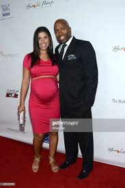 Gwendolyn Smith and former NBA player Kenny Smith arrive at the ...