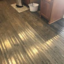 can wood floor cupping be fixed