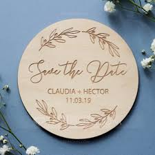 round wooden save the date magnets set