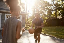 Father And Son Playing Basketball On Driveway At Home In 2020 Father And Son Father Social Media Icons