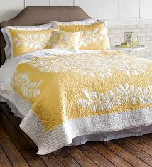 yellow quilts white quilt