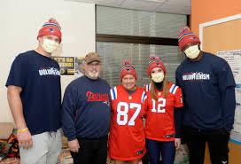 Shilique Calhoun, Ryan Izzo, Alexis Melvin - Ryan Izzo and Alexis Melvin  Photos - New England Patriots Deliver Hats To Patients At Boston Children's  Hospital - Zimbio