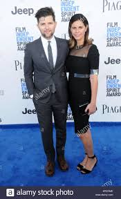 SANTA MONICA, CA - FEBRUARY 25: (L-R) Actor Adam Scott and wife ...