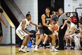 Harvard Men's Basketball Sweeps Yale and Brown | Harvard Magazine