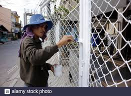 Antipolo City Philippines April 4 2020 Man Catches Up On Home Chores And Paints His House Fence During The Lockdown Due To Covid 19 Virus Outbrea Stock Photo Alamy