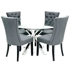 circular glass dining table and 4