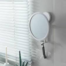 bathroom mirror with shaver holder