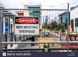 Safety Warning Sign On Fence Near A Construction Site In The District Docklands A Shopping Centre In Melbourne Vic Australia Stock Photo Alamy