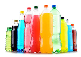 Plastic bottles of assorted carbonated soft drinks over white ...