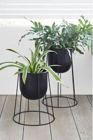 set of 2 black plant pots on stand