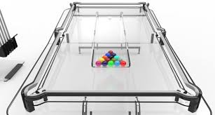 a glass pool table with a catch core77