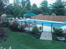 Right Here We Take A Look At 27 Innovative Swimming Pool Fence Ideas For Property Residence In 2020 Backyard Pool Landscaping Inground Pool Landscaping Backyard Pool