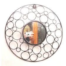 black round wrought iron wall mirror