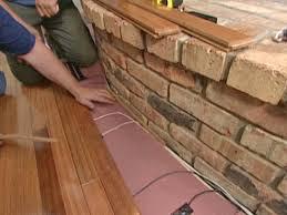 install flooring around a fireplace