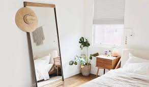 decorate with oversized mirrors