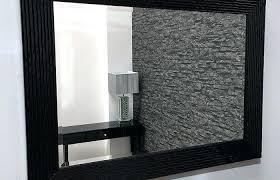 black framed wall mirror geometric