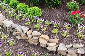 natural rock retaining wall in a garden