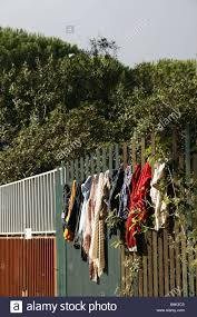 Homeless Immigrant Clothes On Washing Line Fence In Rome Italy Stock Photo Alamy