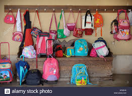 Kids Bags And Backpacks Hanging On Hooks And Lying On The Floor Stock Photo Alamy